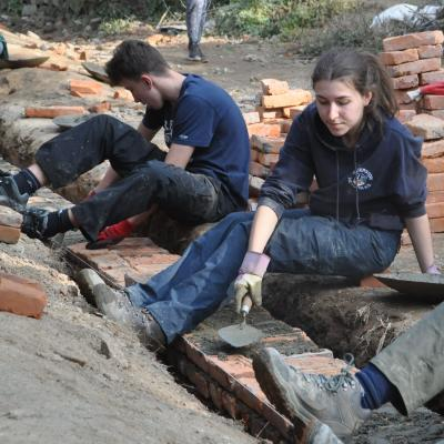 Projects Abroad volunteers laying bricks to make a sturdy school at the Building Project in Nepal for groups
